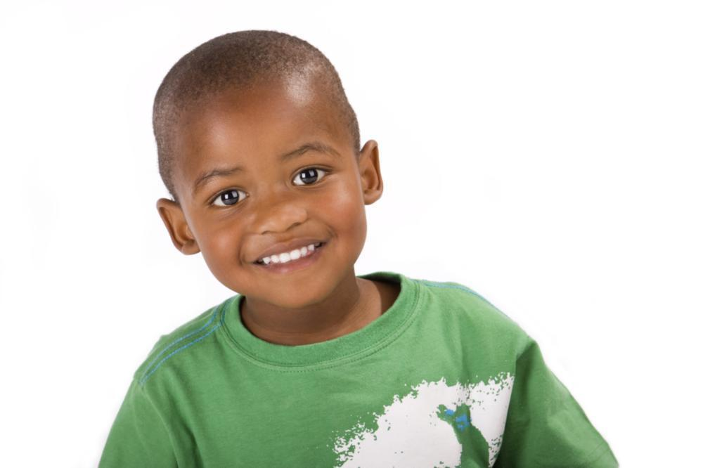 Young boy in green shirt | Dentist Gretna LA