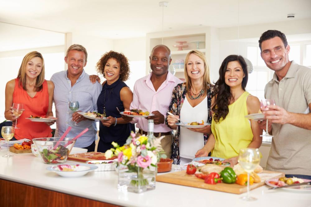 group of people smiling in kitchen | Dentist Gretna LA