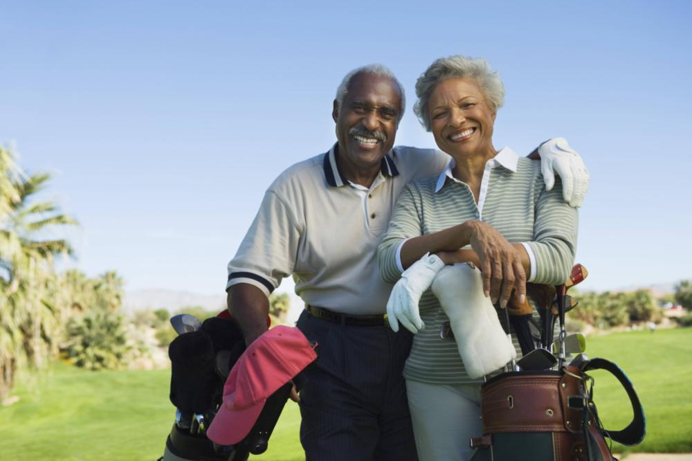 Older couple golfing | dentist gretna LA