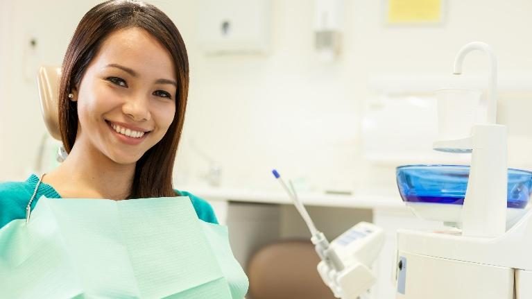 Woman smiling in dental chair | Dentist Gretna LA