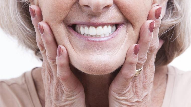 Woman Smiling | Immediate Dentures New Orleans LA