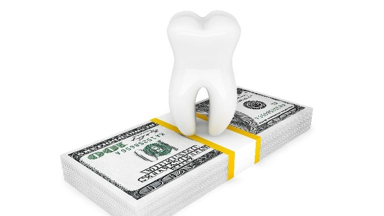 Illustrated Tooth on top of stack of money | NOLA Dentures and General Dentistry